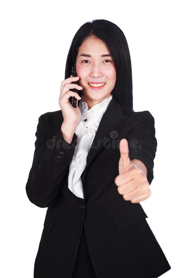 Happy business woman with mobile phone and thumbs up gesture iso stock image