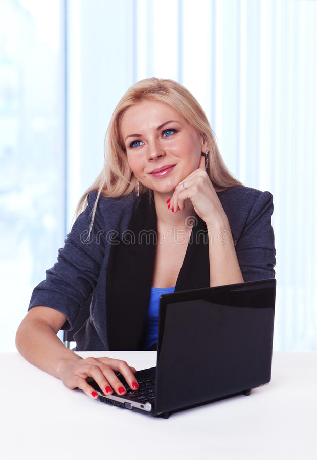 Happy business woman at office desk daydreaming stock photos