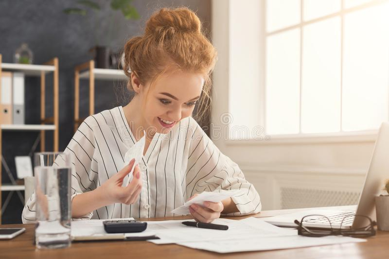 Happy business woman reading checks royalty free stock image