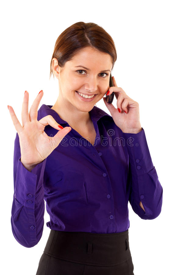 Happy business woman with phone. Happy businesswoman with phone and thumbs up gesture, isolated royalty free stock images