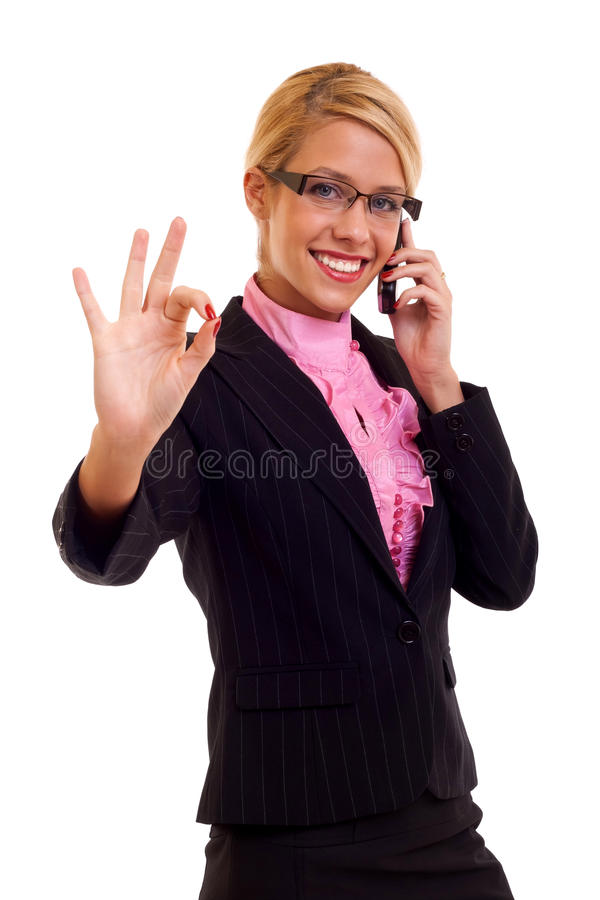 Happy business woman with phone. And thumbs up gesture, isolated royalty free stock image