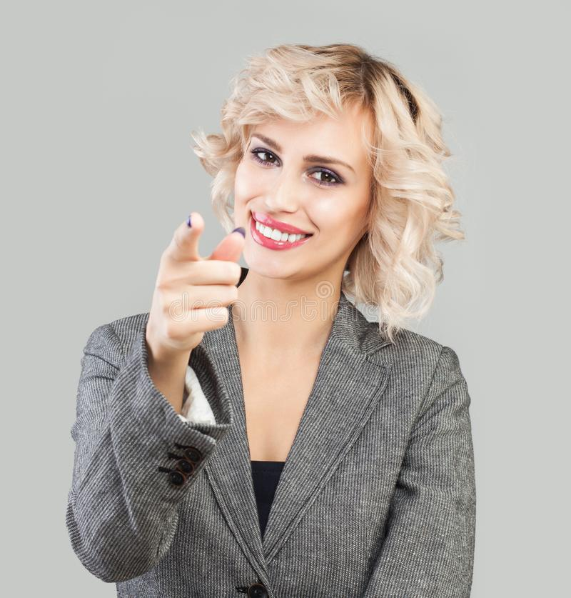 Happy business woman pointing finger stock photos