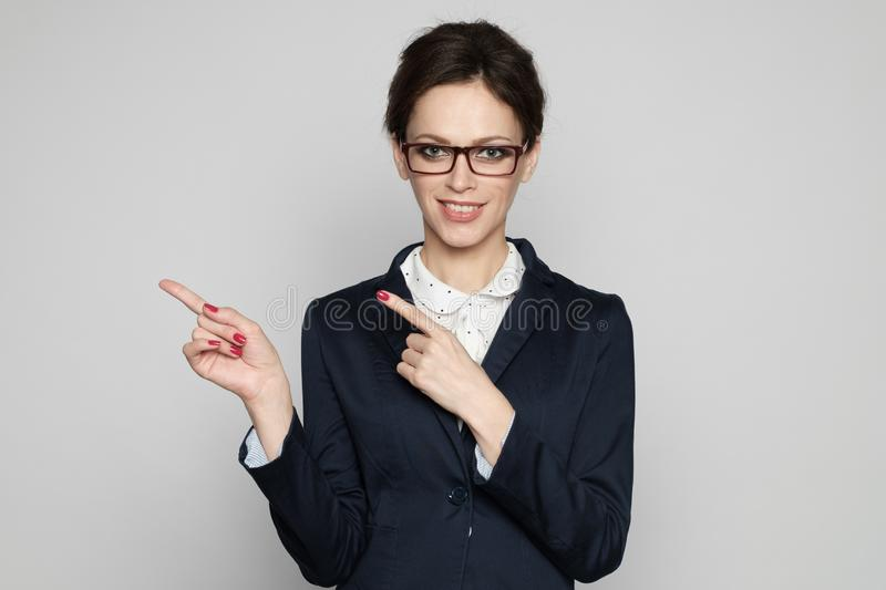 Happy business woman pointing ger fingers stock photo