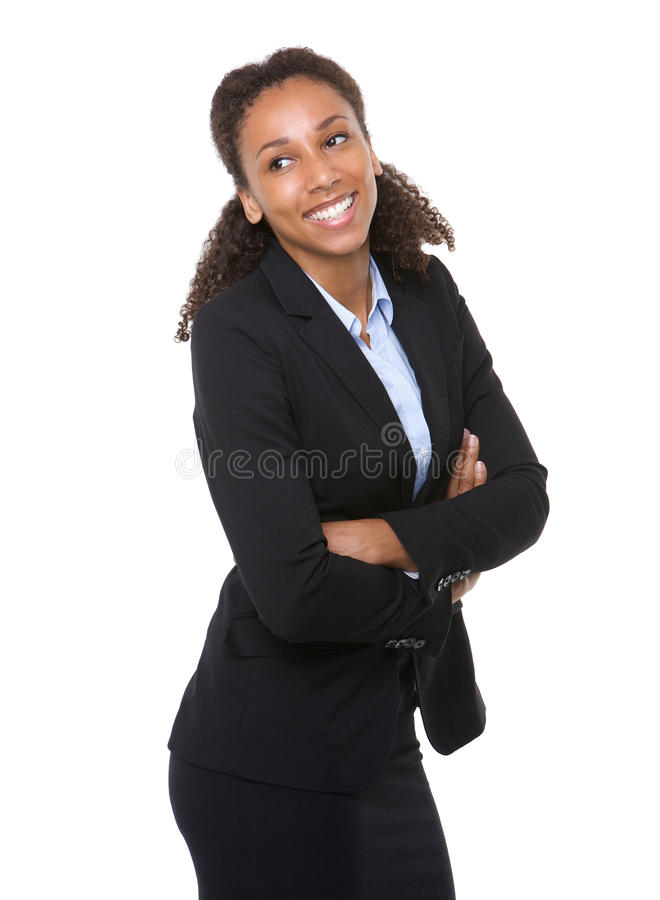 Happy business woman. Portrait of a happy business woman posing with arms crossed on isolated white background stock photography