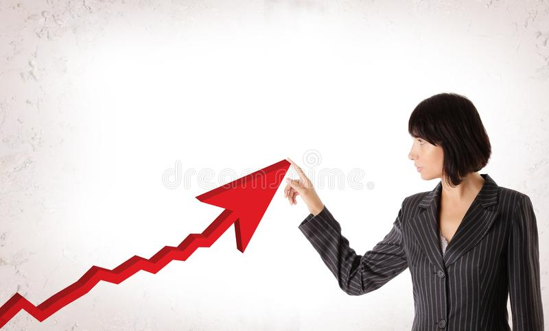 Happy Business Woman with Rising Arrow royalty free stock photography