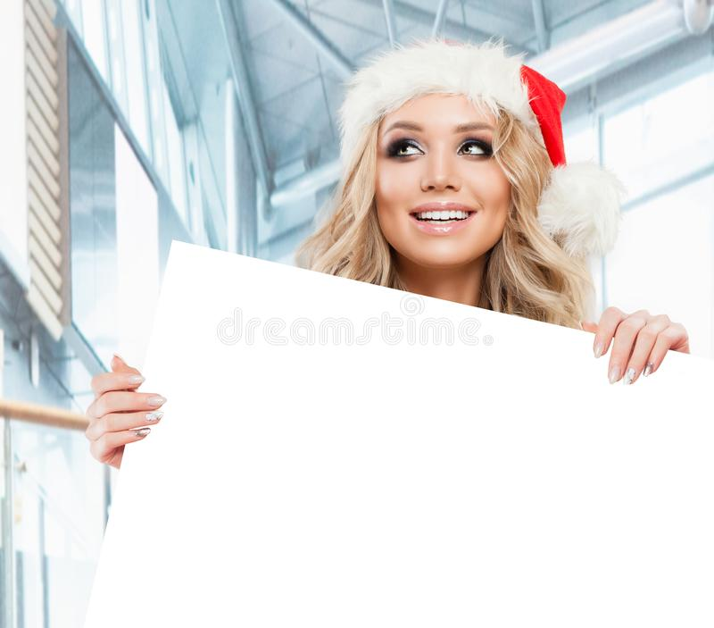Happy business woman in Santa hat looking up royalty free stock photo