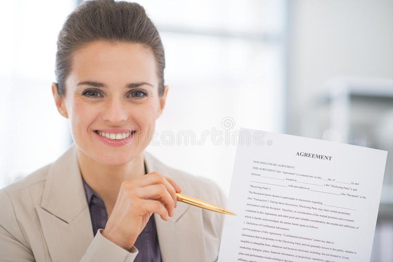 Happy business woman showing agreement. Portrait of happy business woman showing agreement royalty free stock photos