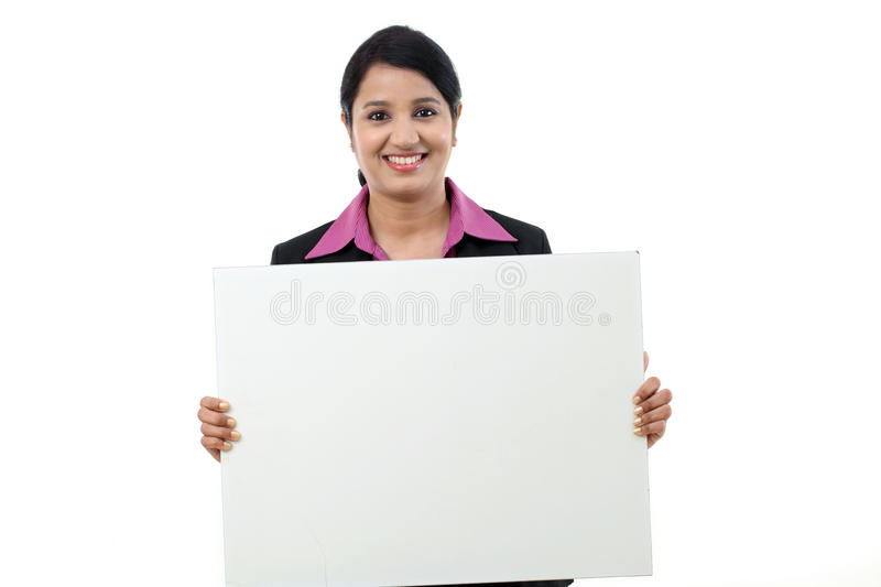 Happy business woman showing blank signboard royalty free stock photo