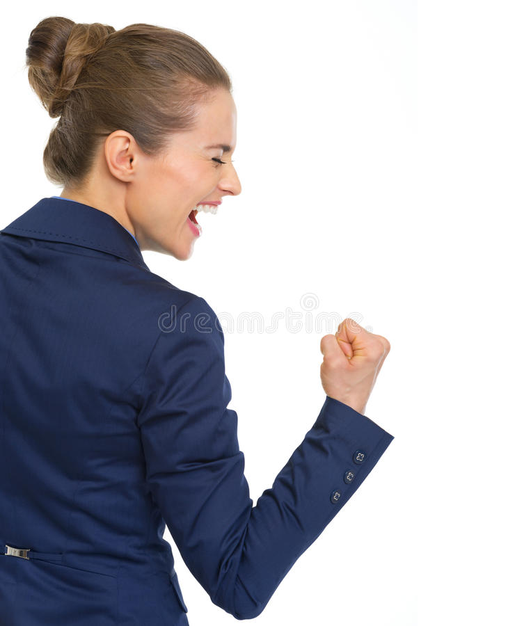 Happy business woman showing fist pump gesture stock photos