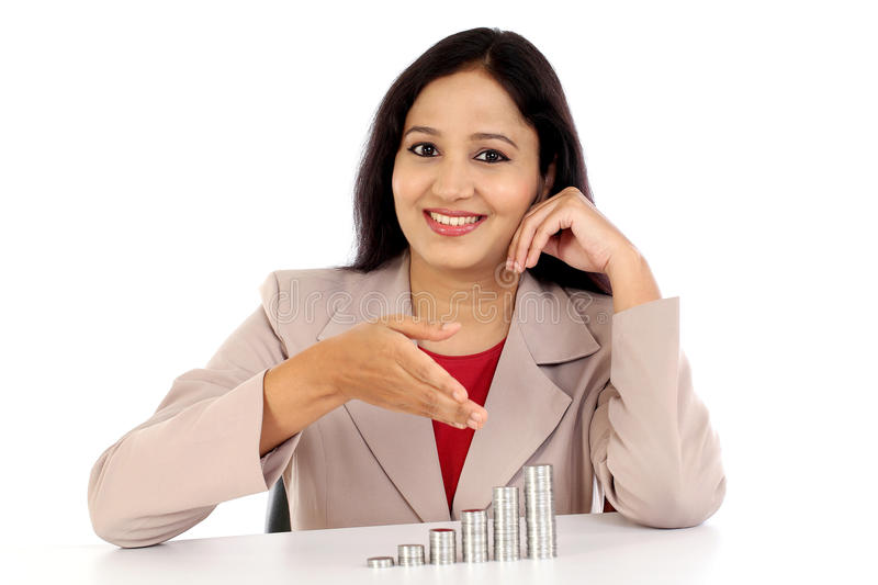 Happy business woman showing stack of coins stock photo