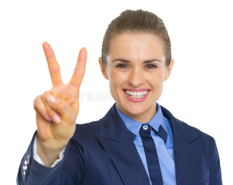 Happy business woman showing victory gesture. Isolated on white background stock photo