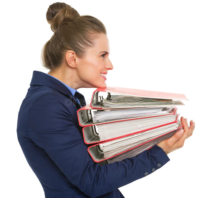 Happy business woman with stack of folders. Profile portrait of happy business woman with stack of folders royalty free stock photography