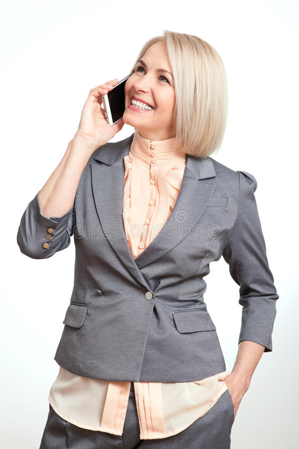 Happy business woman talking on smartphone on white background royalty free stock images