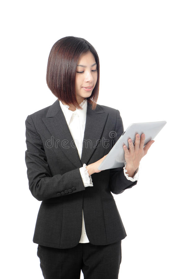Happy business woman usiing tablet pc. Happy business woman using tablet pc computer isolated on white background, model is a asian beauty stock photo