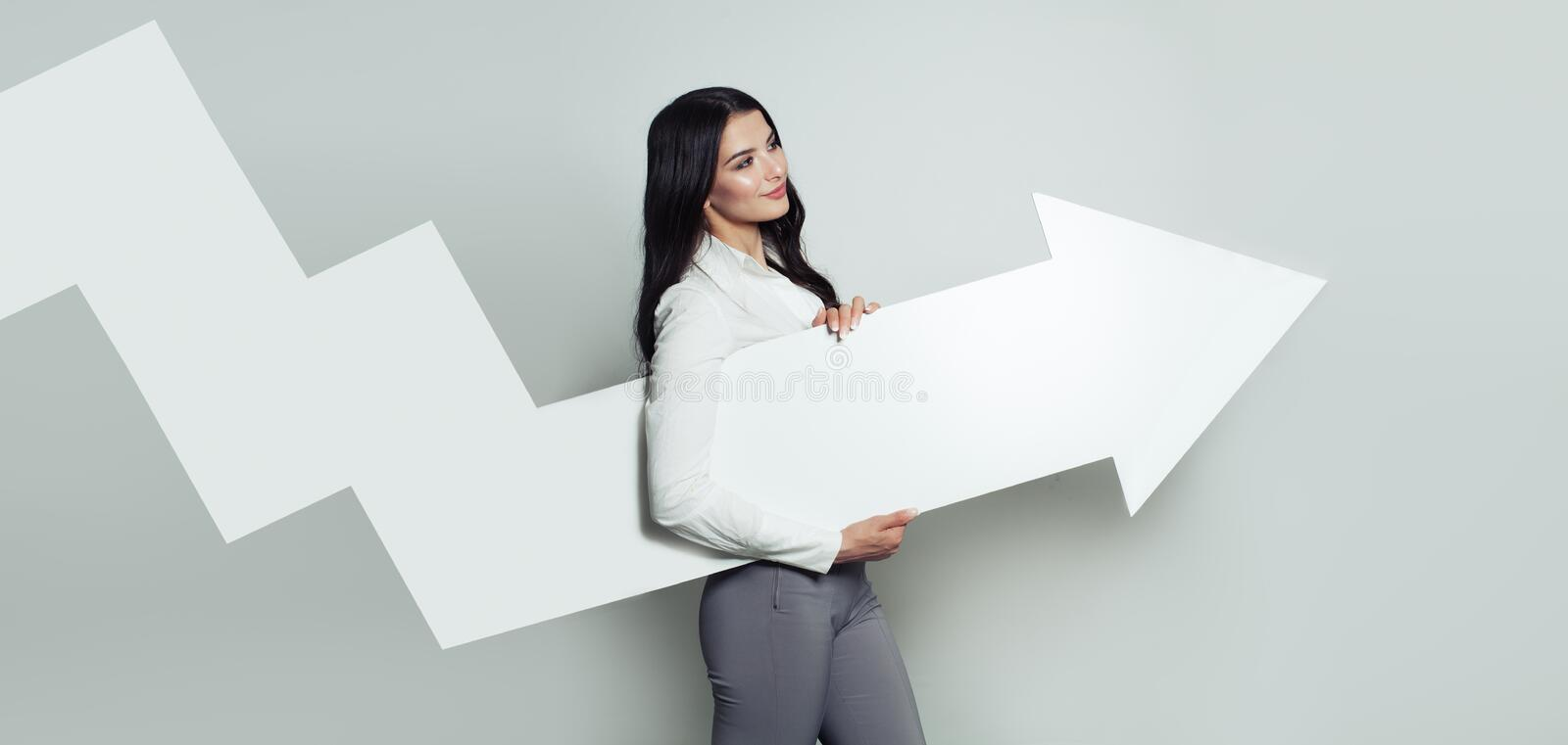 Happy Business Woman with White Empty Rising Arrow royalty free stock images