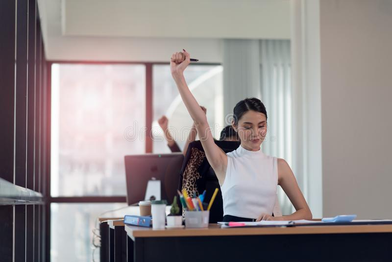 Happy business woman working in the office with your hands up royalty free stock photos