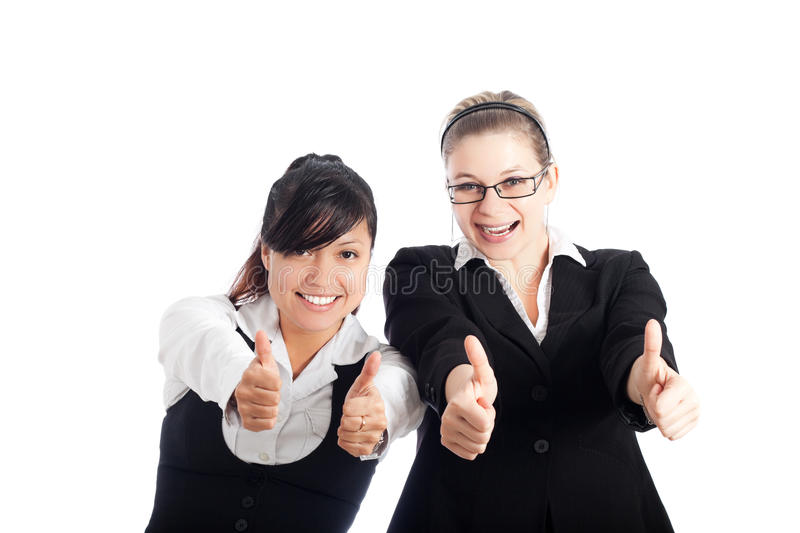 Happy business women thumbs up stock photos