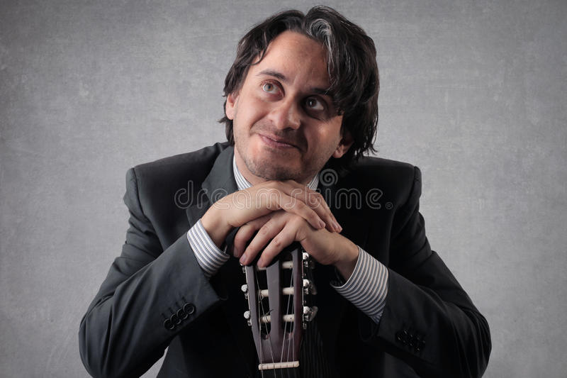 Download Happy Businessan With A Guitar Stock Photo - Image of elegance, male: 39505060
