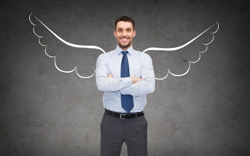 Happy businessman with angel wings over gray royalty free stock photos