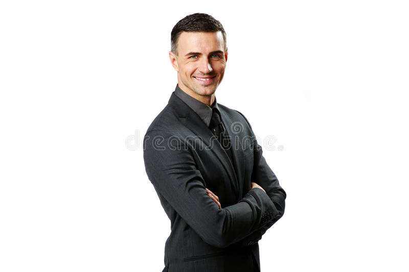 Happy businessman with arms folded. Portrait of a happy businessman with arms folded isolated on a white background stock photography