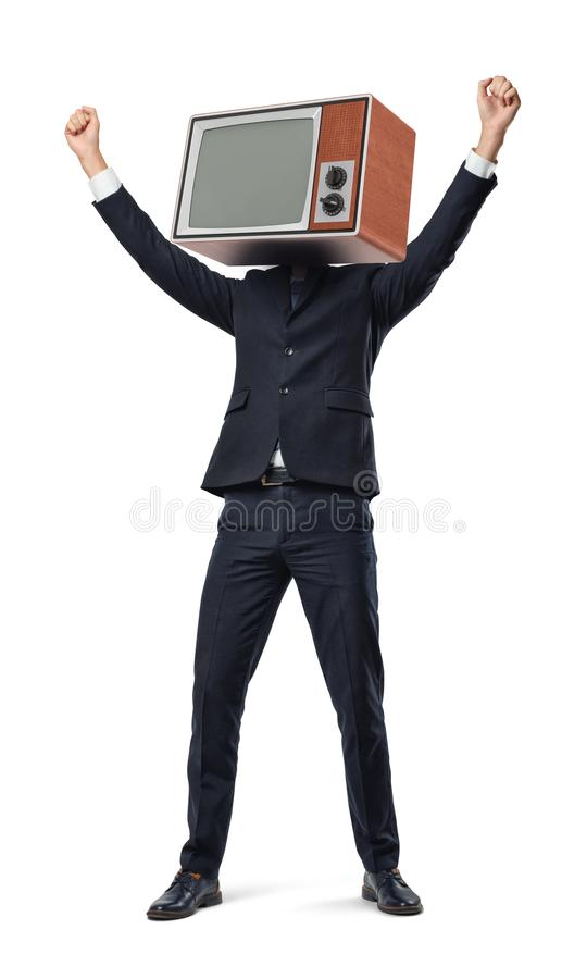 A happy businessman with arms raised in victory motion wears an old TV set instead of his head. royalty free stock images
