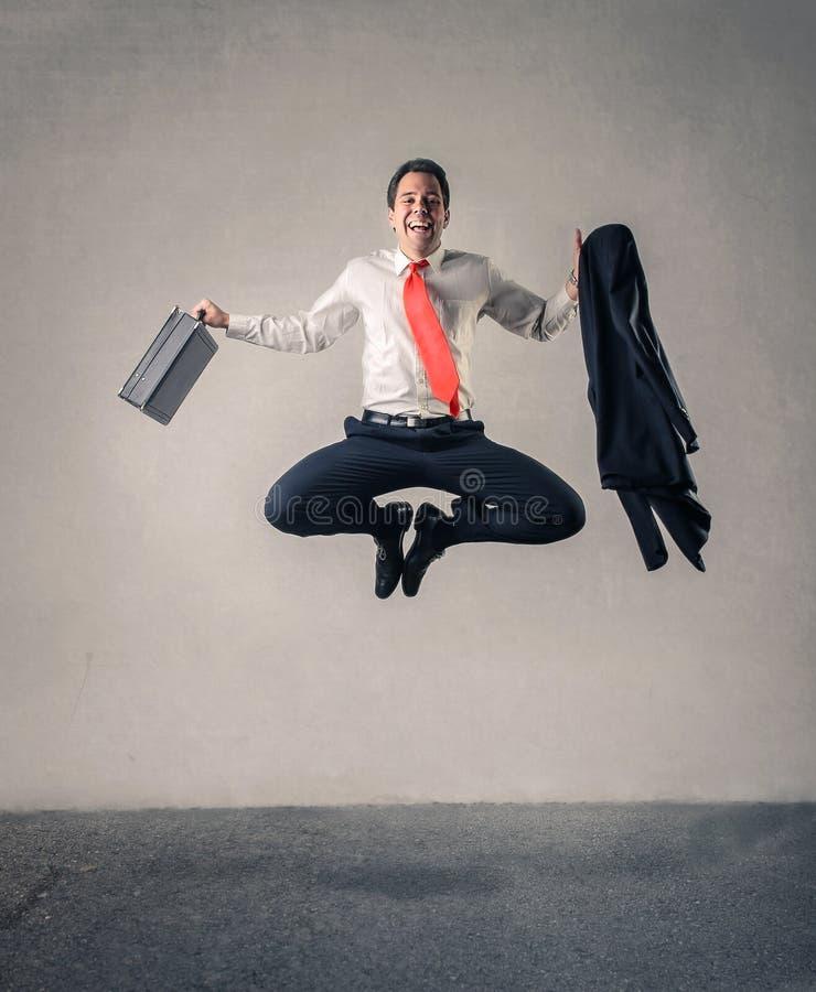 Happy businessman jumping royalty free stock photo