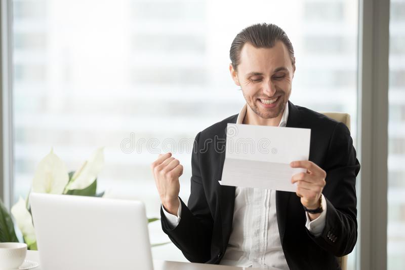 Happy businessman celebrates receiving good business news in let royalty free stock photos