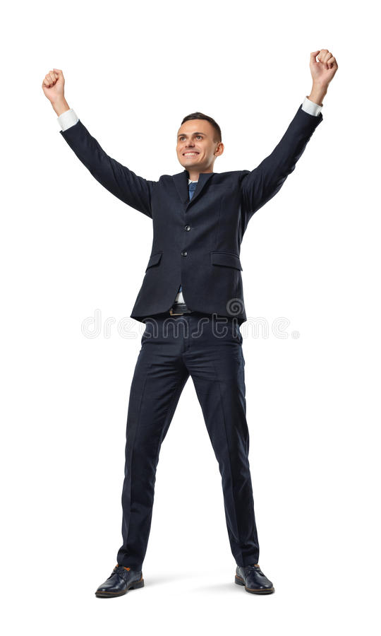 Happy businessman in celebrating pose isolated on the white background. royalty free stock photo