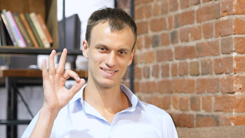 happy businessman or creative male office worker showing ok hand sign stock photography