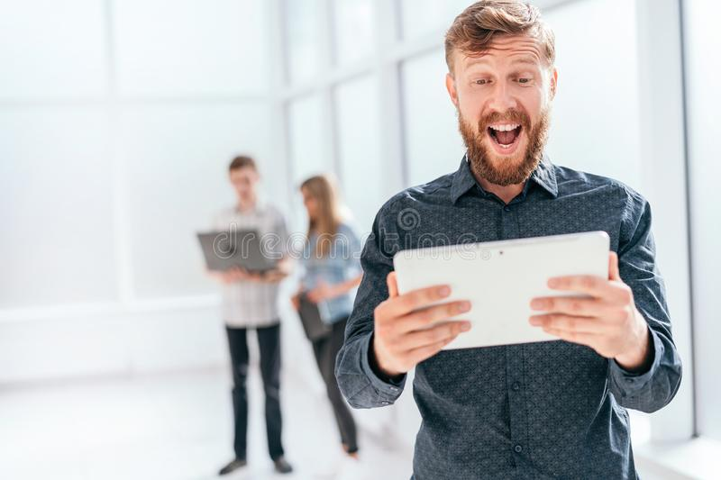 Happy businessman with digital tablet standing in office royalty free stock images