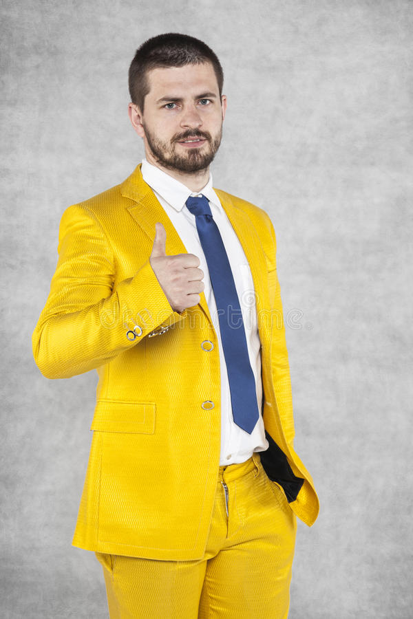 Happy businessman in gold suit show thumbs up. Happy business man in gold suit show thumbs up stock images