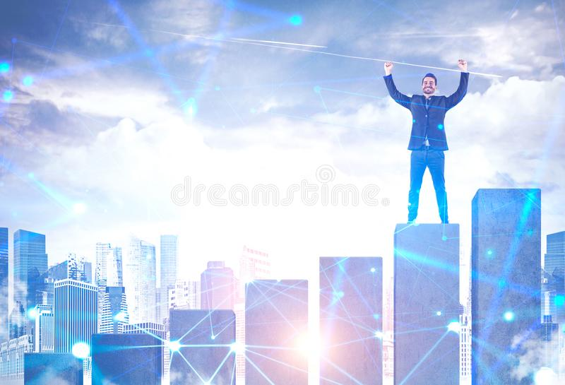Happy businessman on graph in city, network royalty free stock images