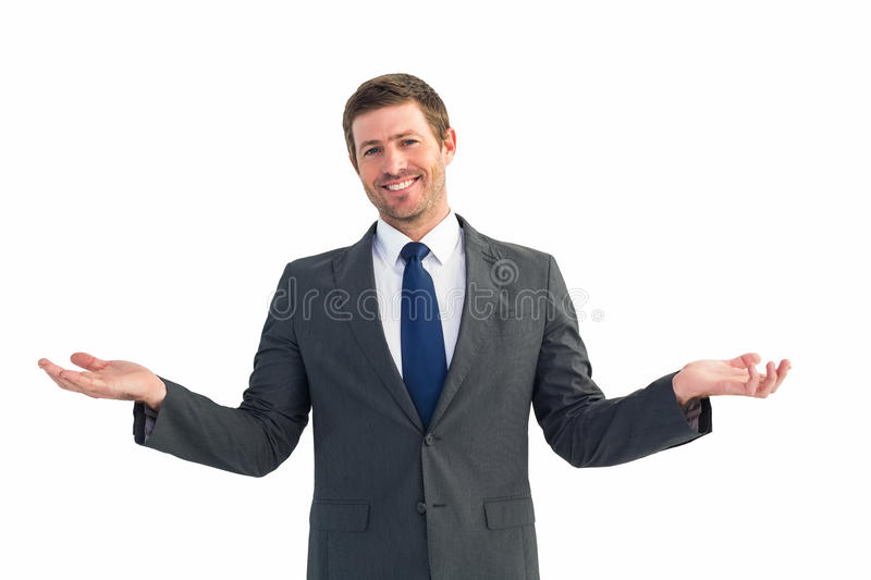 Happy businessman with hands out. On white background royalty free stock photography