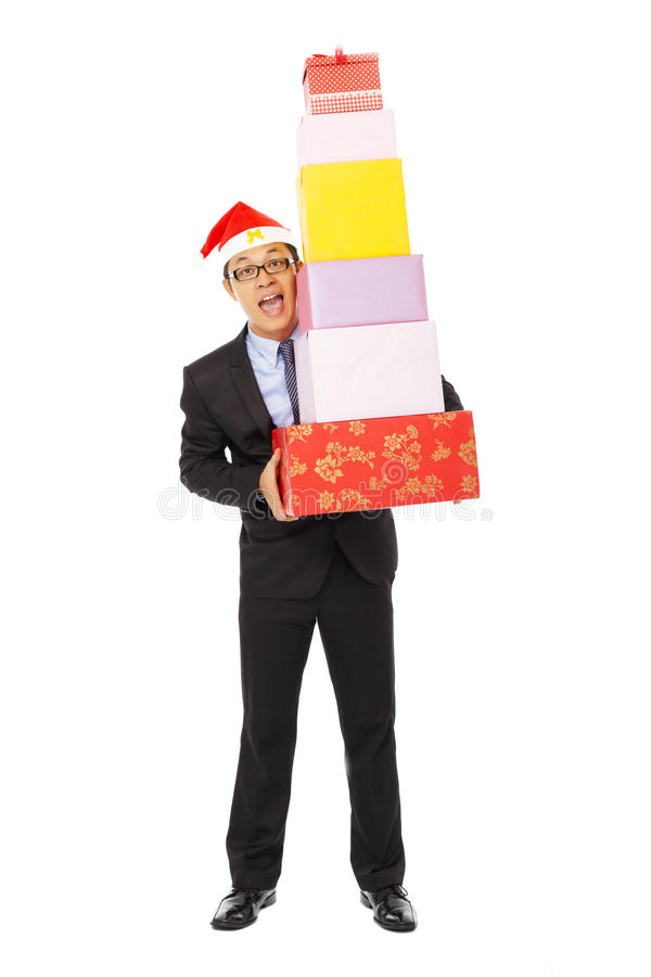 Happy businessman holding gift boxes . isolated on white. Background stock photography