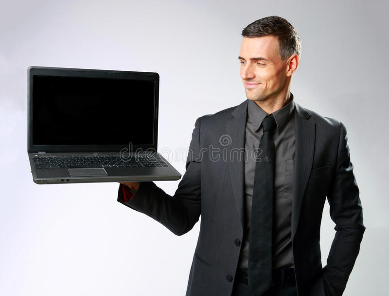 Download Happy Businessman Holding Laptop Stock Image - Image of screen, smiling: 39100169
