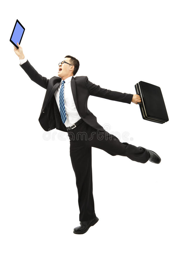 Happy businessman holding tablet pc royalty free stock image