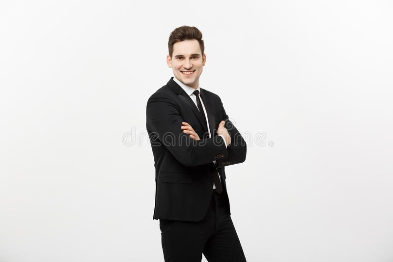 Happy businessman isolated - Successful handsome man standing with crossed arms isolated over white background. royalty free stock images