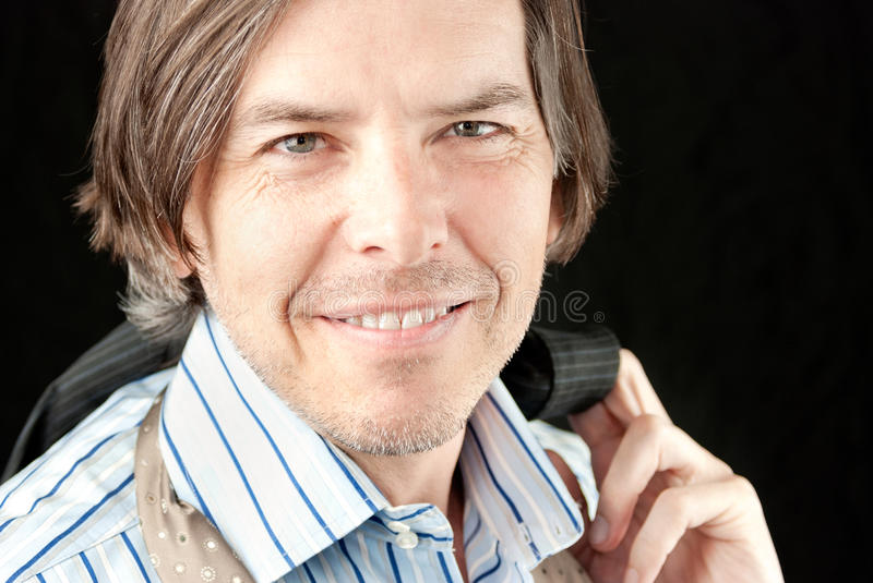 Happy Businessman With Jacket Over Shoulder Royalty Free Stock Images