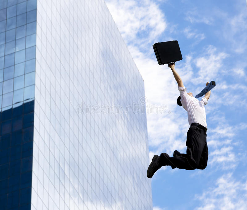 Happy businessman jumping royalty free stock photography