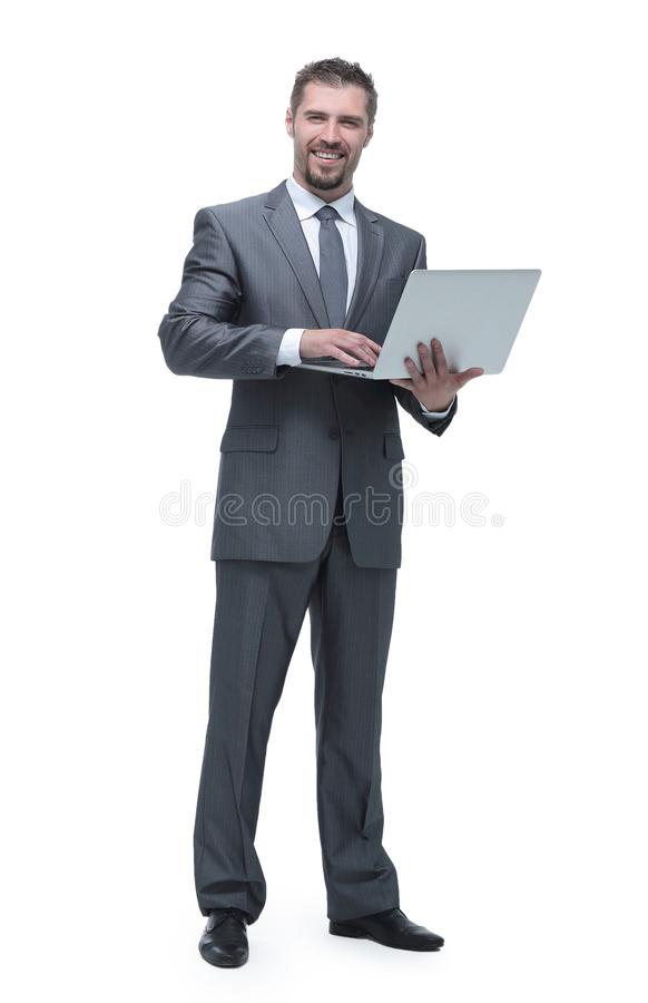 Happy businessman with a laptop. royalty free stock photography