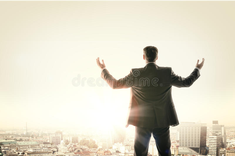 Happy businessman looks sunrise in city royalty free stock images