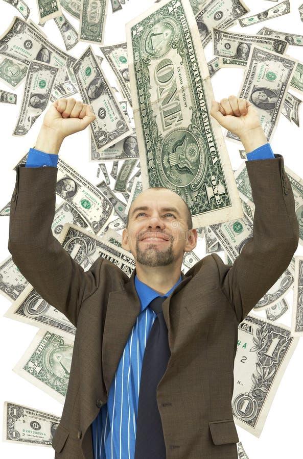 Happy businessman on the money background stock photos