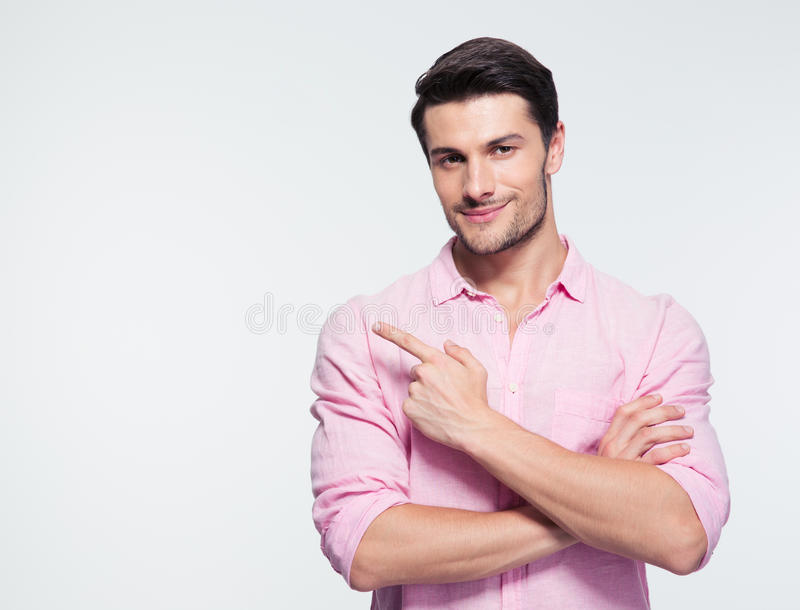 Happy businessman pointing finger away royalty free stock photography