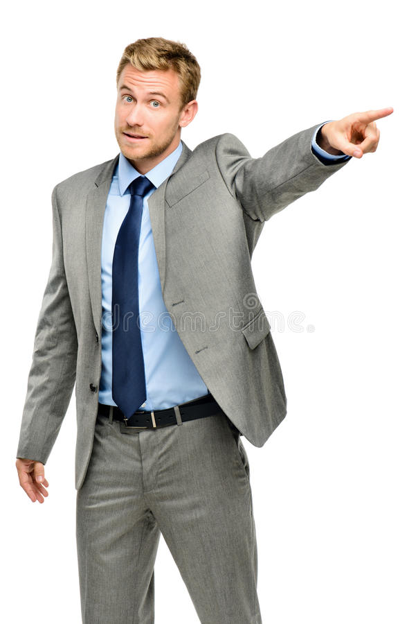 Happy businessman pointing on white background royalty free stock image