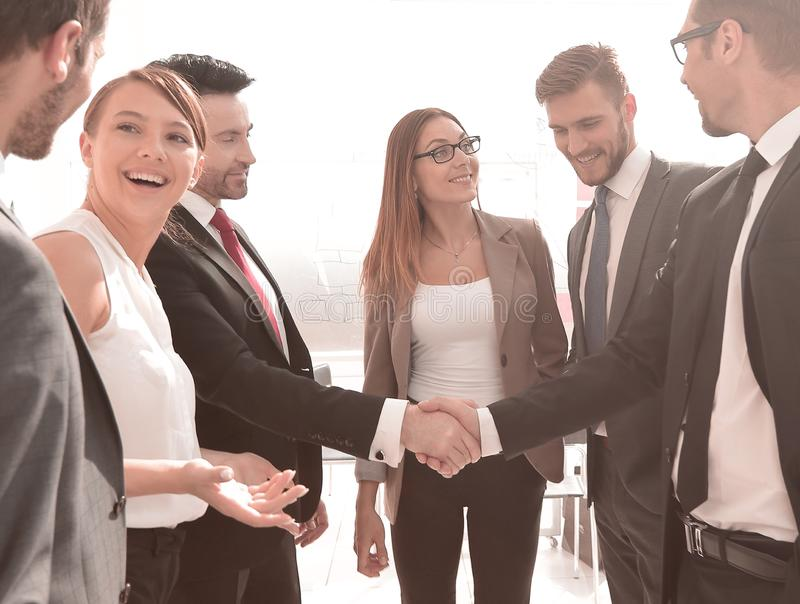 Business handshake in a modern office royalty free stock photography