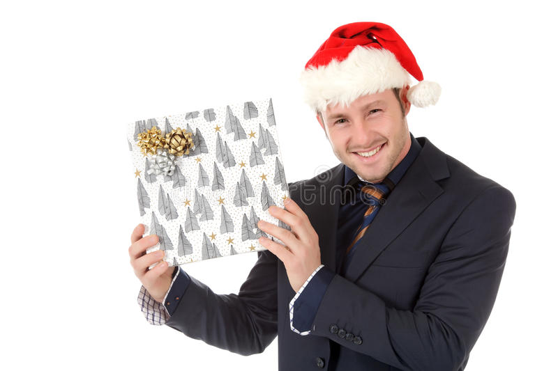 Happy businessman with santa hat, gift. Happy young caucasian businessman with Santa hat showing Christmas gift . Studio shot. White background stock images