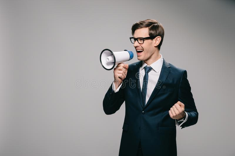 Happy businessman screaming in megaphone stock photography