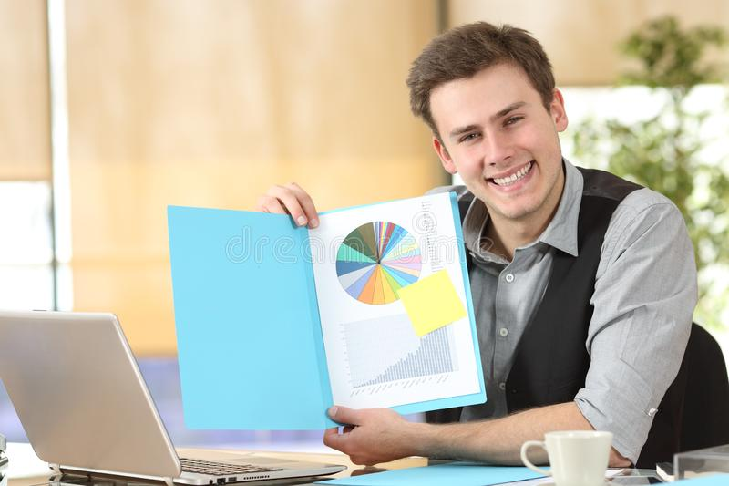 Happy businessman showing blank document at camera royalty free stock photo