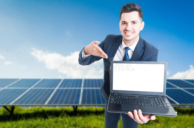 Happy businessman showing laptop with blank screen royalty free stock photo