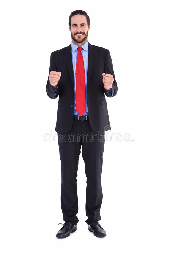 Happy businessman showing something to camera royalty free stock photo